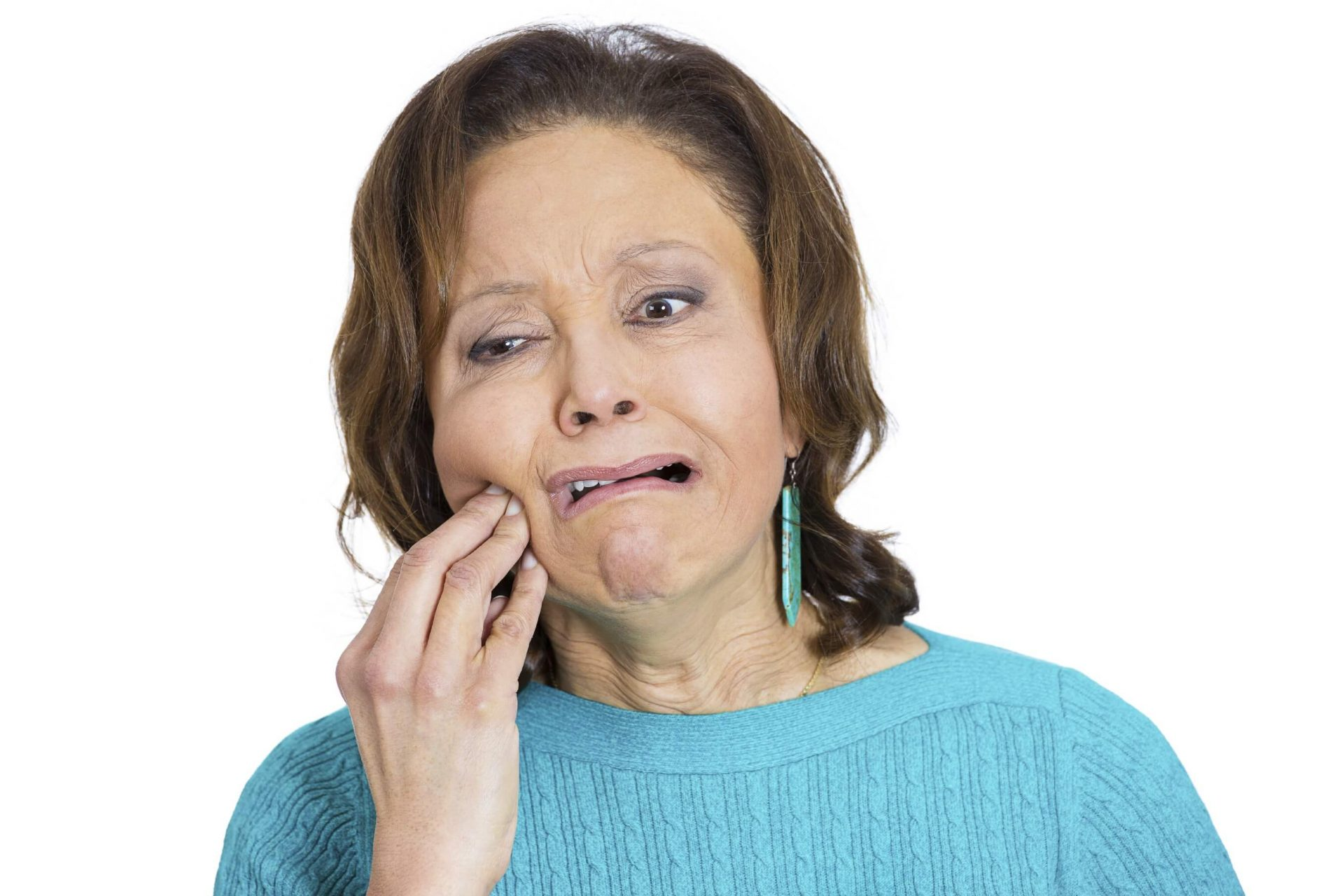Closeup portrait, elderly business woman with tooth ache, crown problem, cavity pain, touching outside mouth with hand, isolated white background. Negative human emotion facial expression feeling